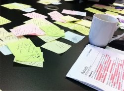 Image of post its and coffee cup