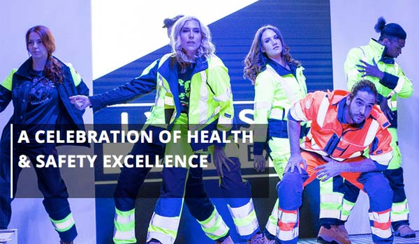 workers modelling health and safety clothing