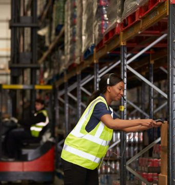 warehouse worker scanning consignment