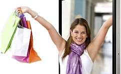 Happy lady with arms rasied holding shopping bags