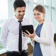 tablet used in standing meeting scene