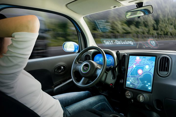 image of driver relaxing in the cockpit of a driverless car