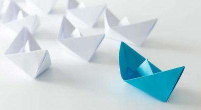 blue paper boat representing leadership