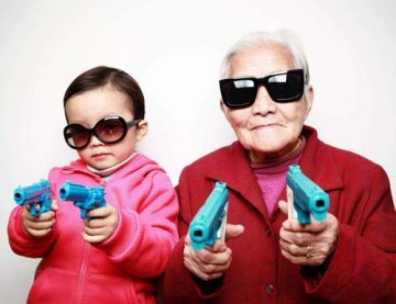 girl and older woman brandish toy guns