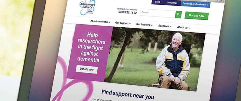 alzheimers society website displayed on laptop screen