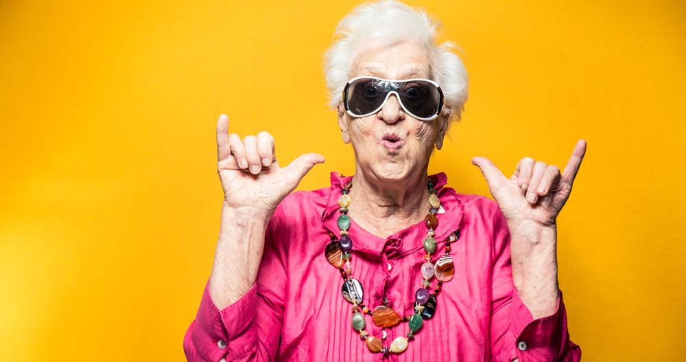 cool granny gives sign of the horns