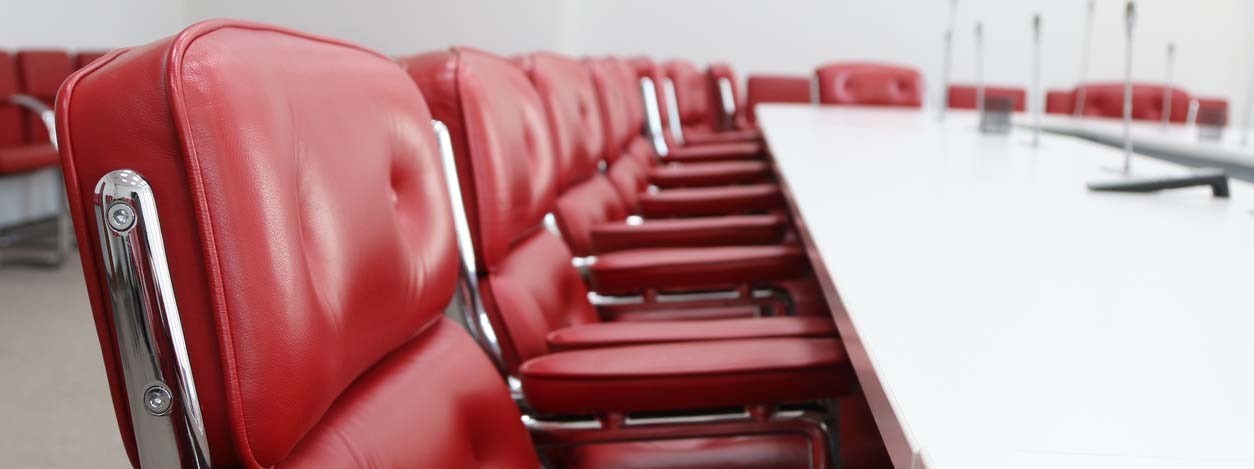 empty red conference chairs