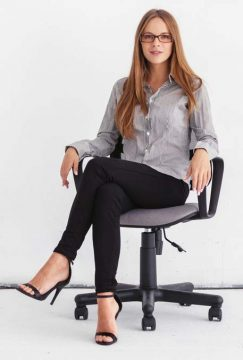 woman sitting on swivel chair