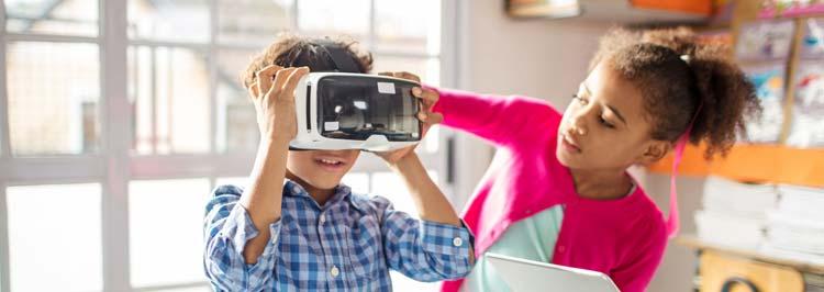 girl helping boy try vr technology
