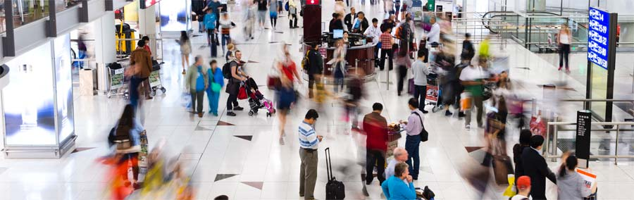 travellers in busy public transit hub