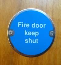 close up of fire door keep shut sign