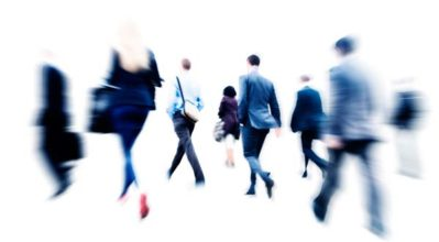 employees walking with blurred background effect