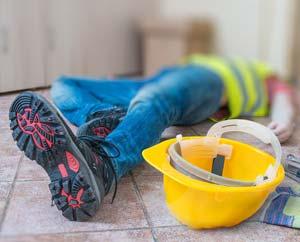 injured worker lying on floor