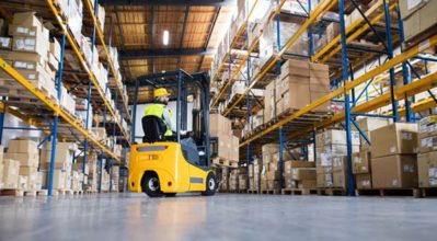 forklift moving goods in warehouse