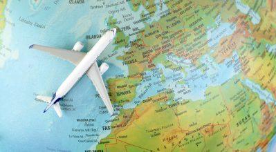 Toy plane on world globe
