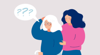 Young female volunteer is caring for an elderly person with dementia. Senior woman leans on a cane, and a social worker supports and helps her.