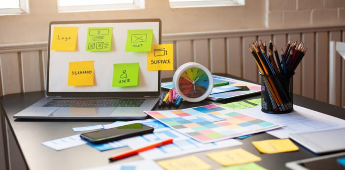 """(alt=A Designers desk set up ready to carry out user experience strategy"""")"""
